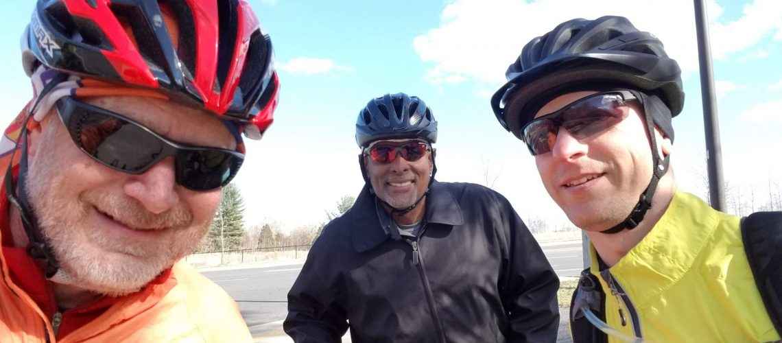 In a world before social distancing was a thing, Paraclete Associate Steve Spinella (left) combined counseling ministry and cycling in 2019.